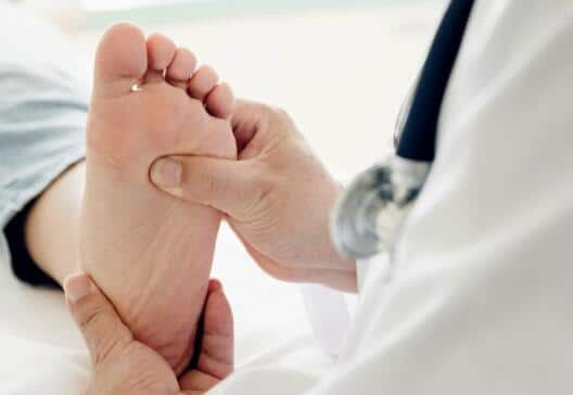 causes of sore feet
